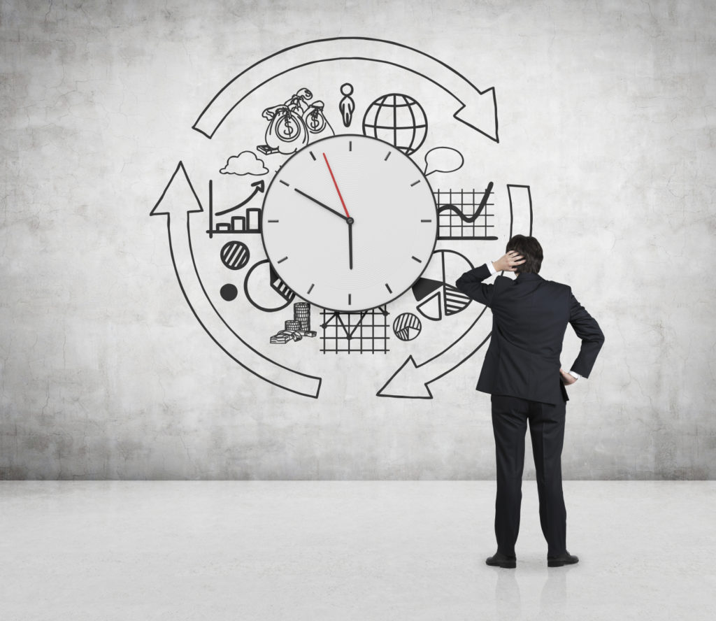 businessman looking to drawing business time concept on wall